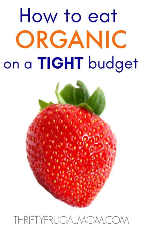 a large strawberry on a white background with the words how to eat organic on a budget