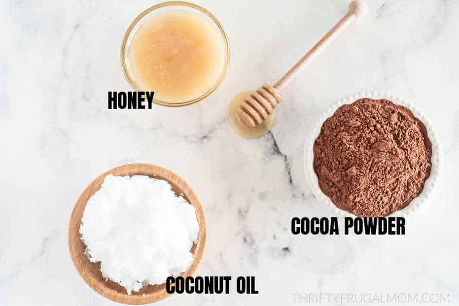 coconut oil, cocoa powder and honey in bowls