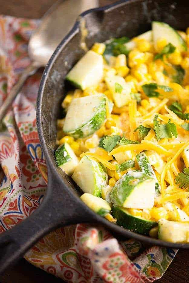 creamy corn and diced zucchini in cast iron skillet