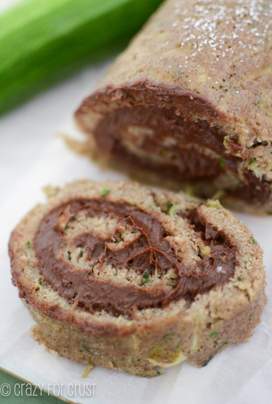 zucchini cake roll with chocolate cream cheese icing on a plate