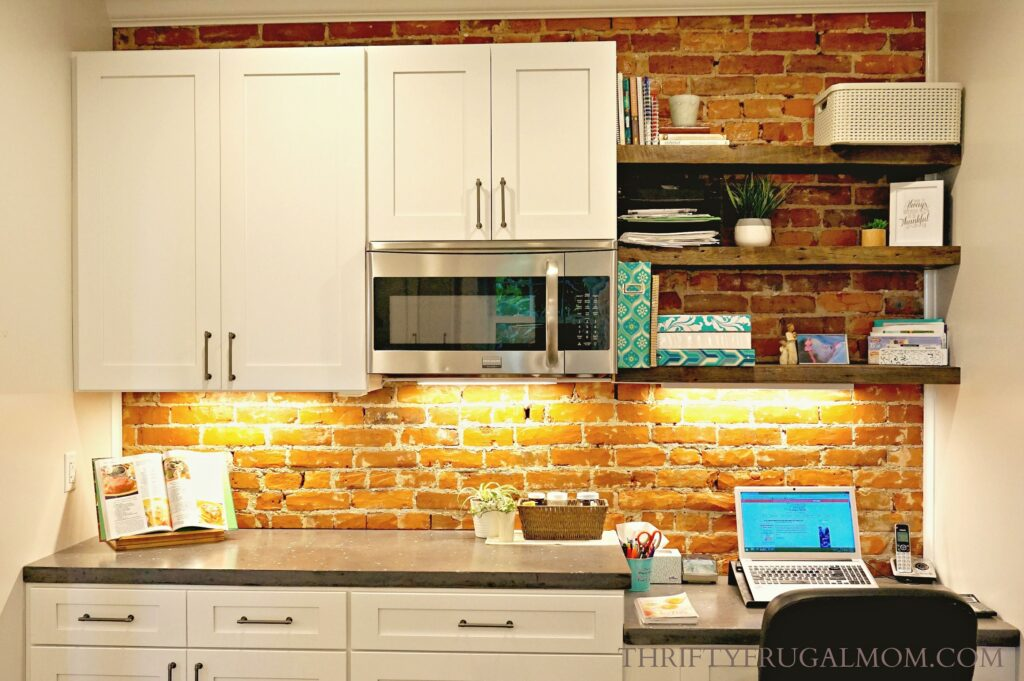 Exposed brick back splash in kitchen