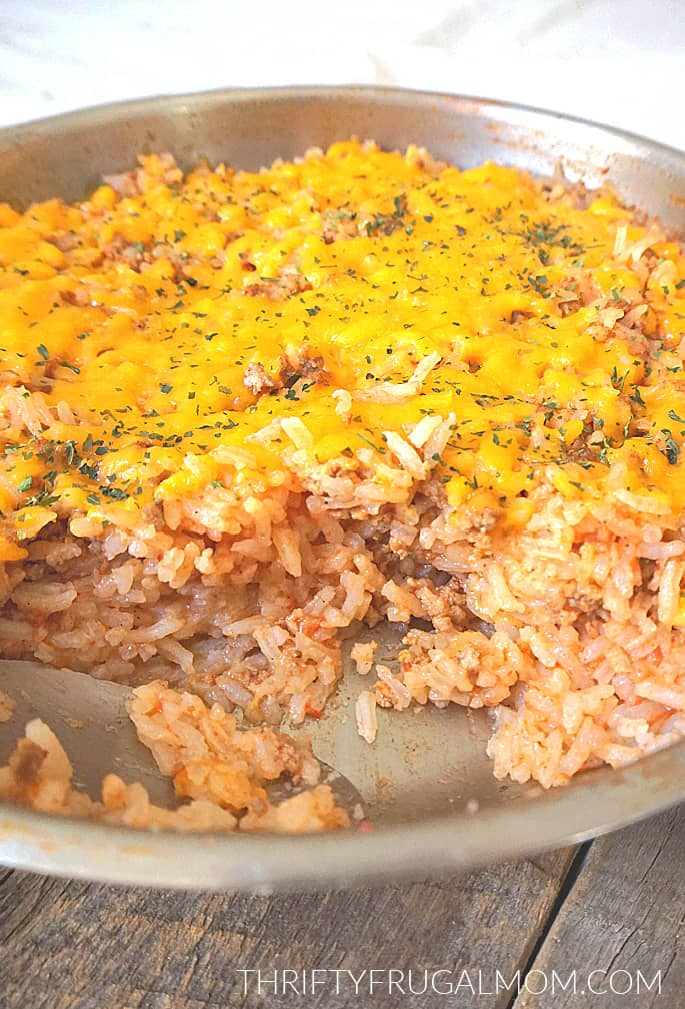 spanish rice with ground beef in a partially full skillet