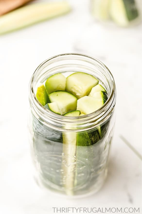 cucumber slices in a canning jar to make pickles