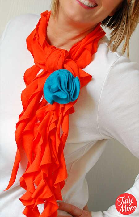 an orange scarf on a woman wearing a white shirt