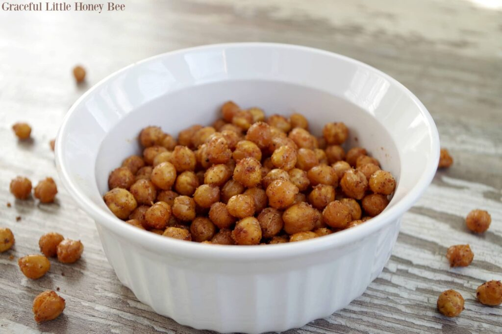 healthy snack of roasted chickpeas in a white bowl