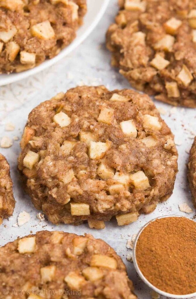 an apple oatmeal cookie on a white background- great healthy snack idea