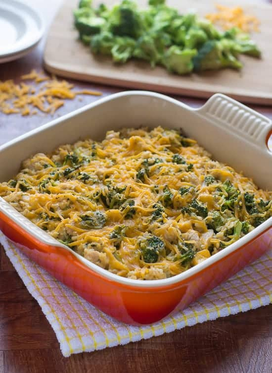 Easy, cheap and healthy Chicken Broccoli Rice Casserole in a red baking dish