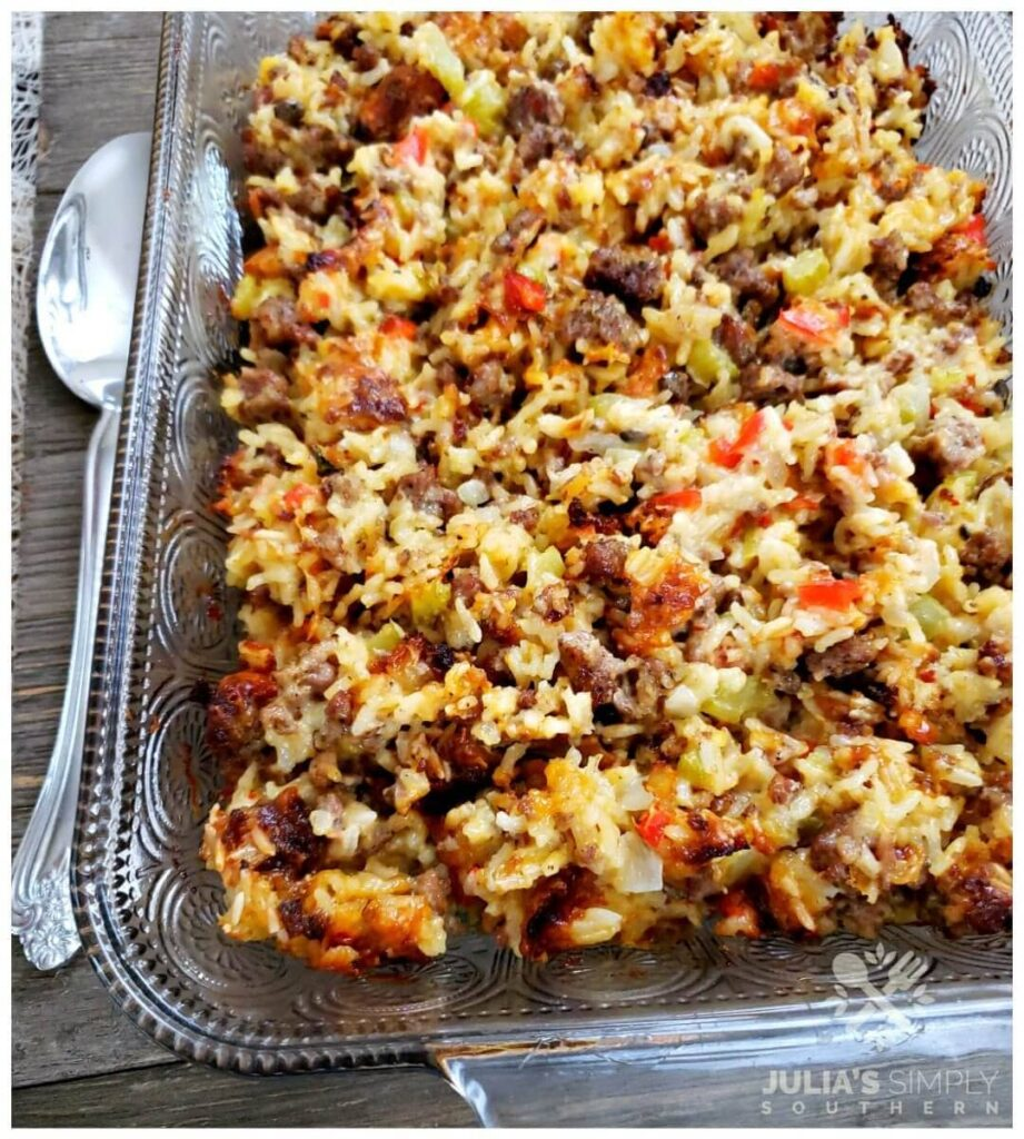 Easy Sausage and Rice Casserole in a glass casserole dish with a spoon beside it