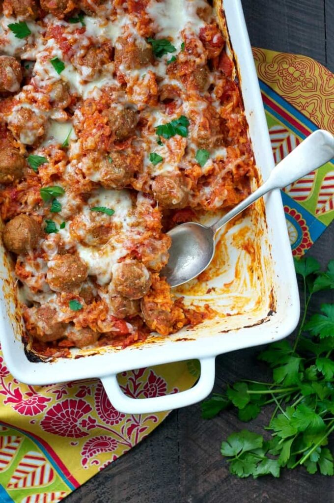 quick and easy Italian meatball and rice casserole in a 9x13 white pan
