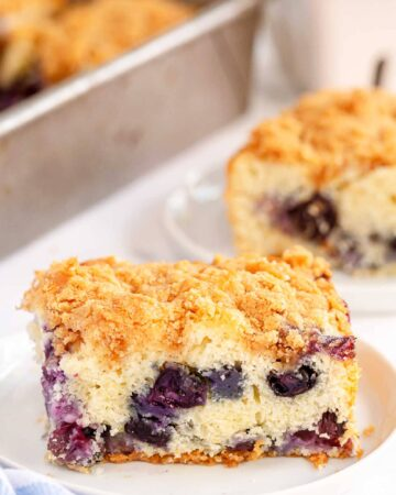 a piece of Blueberry Buckle Cake on a white plate
