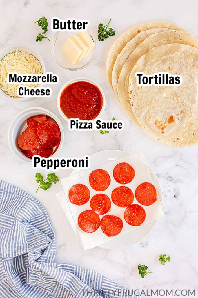 pepperoni pizza quesadilla ingredients laid out on a marble table